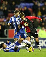 Photo: Paul Greenwood/Sportsbeat Images.<br />Wigan Athletic v Blackburn Rovers. The FA Barclays Premiership. 15/12/2007.<br />Blackburn's Morten Gamst Pedersen (R) is tackled by Wigan's Denny Landzaat.