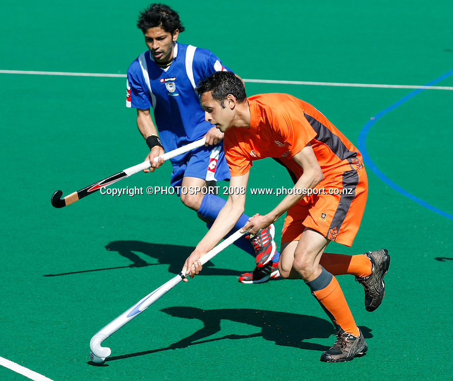 976655df27a ... National League Mens Final. Midland s Sanjay Patel runs the ball  against the defence of Auckland s Rakesh Parsotam. Hockey