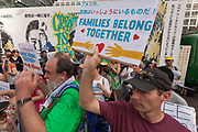 People take part in the families Belong Together Rally to protest the policy of separating migrant families as they cross the Southern US border carried out by the Administration of President Donald Trump in Tokyo's iconic Hachiko Square in Shibuya, Japan. Saturday June 30th 2018. Around thirty people from Democrats Abroad Japan, along with Japanese and other foreigners, took part in the demo which was part of an international day of action that saw more than 625 protests worldwide.