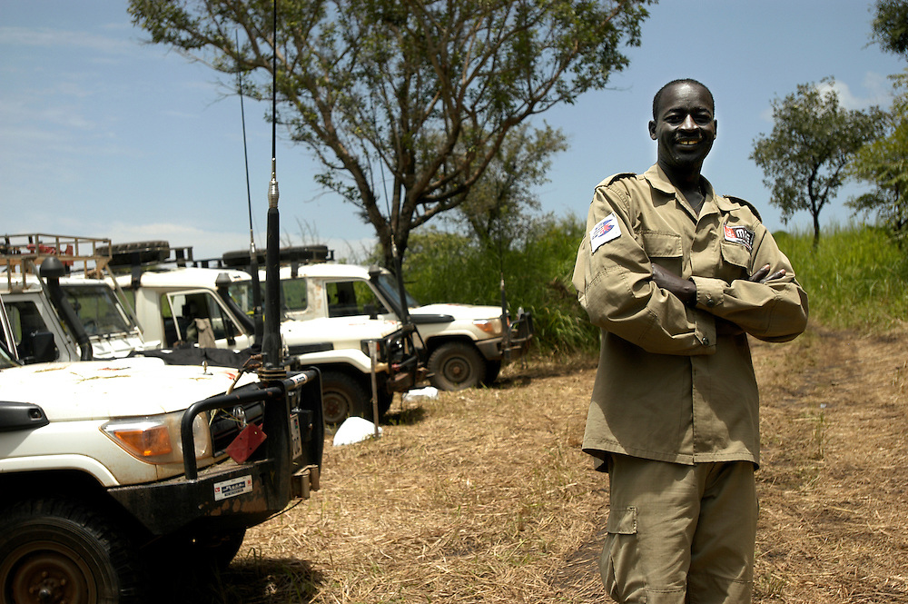 Akech Athieu, Mines Advisory Group (MAG)'s first national Technical Field Manager, at a minefield that his team is clearing near a former goverment position overlooking the town of Morobo. The position was subsequently overrun by the SPLA. The area is inhabited by people who returned to their land following the conflict and are prevented from cultivating food or rebuilding their lives..Morobo, South Sudan. 02/10/2009..Photo © J.B. Russell