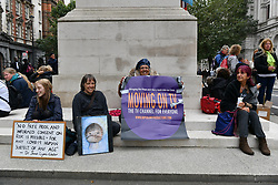 © Licensed to London News Pictures. 29/08/2020. London, UK. Protesters sit on the Cenotaph war monument outside Downing St taking part in a demonstration organised by Stand Up X organisation in London, United Kingdom on August 29,2020. The group is against the British government policy of Covid-19 measures including mask wearing, vaccinations and lockdown. Photo credit: London News Pictures
