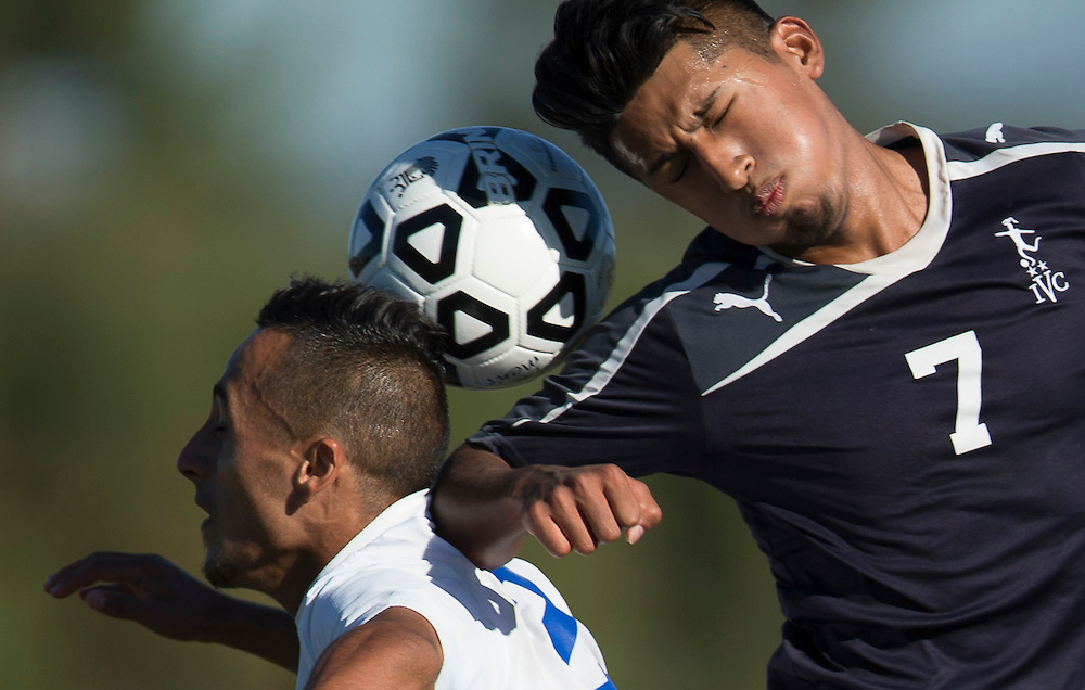 Irvine, CA; November 7,2014 - Fernando Arroyo #7 of Irvine College and #3 Christian Carrillo battle for the ball in Mens Soccer league action at Irvine Valley College.