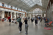 Dancers at Le Centquatre Paris, a public arts space opened in October 2008 on the rue d'Aubervilliers, in the 19th arrondissement of Paris, France. The 104 space features screening rooms, event spaces, exhibition spaces and office space. It is used for performing arts, audiovisual arts, theatre and dance, with shows, concerts, exhibitions and classes, markets and pop-ups, with the public welcome. The building was originally designed by Edouard Delebarre de Bay and Godon and built 1870-74 as a municipal undertakers. Picture by Manuel Cohen
