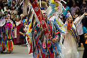 Dancers make their way into the arena during Grand Entry at the 31st annual Gathering of Nations Powwow, held at The University of New Mexico in Albuquerque; this powwow is considered to be the largest in North America.