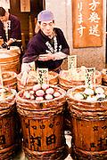 Salesman at Uchida pickled vegetables (large store.) Nishiki Market, Kyoto