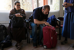 Father Adday sits at a bus terminal before departing for Kirsehir to visit Iraqi Christians.<br /> Next to him is Sister Diba, left, and Sister Catherine, right, who accompanied him during the first day of his trip. <br /> Father Adday is carrying one luggage with all the items needed for mass. He has been traveling across Turkey visiting Iraqi Christians since he became a priest two years ago.