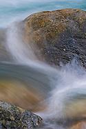 Detail of water moving across rocks in stream near Fallen Leaf Lake, near South Lake Tahoe, El Dorado County, California