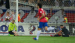 NOVI SAD, SERBIA - Tuesday, September 11, 2012: Wales' goalkeeper Boaz Myhill and Darcy Blake look dejected as Serbia score the fourth goal during the 2014 FIFA World Cup Brazil Qualifying Group A match at the Karadorde Stadium. (Pic by David Rawcliffe/Propaganda)