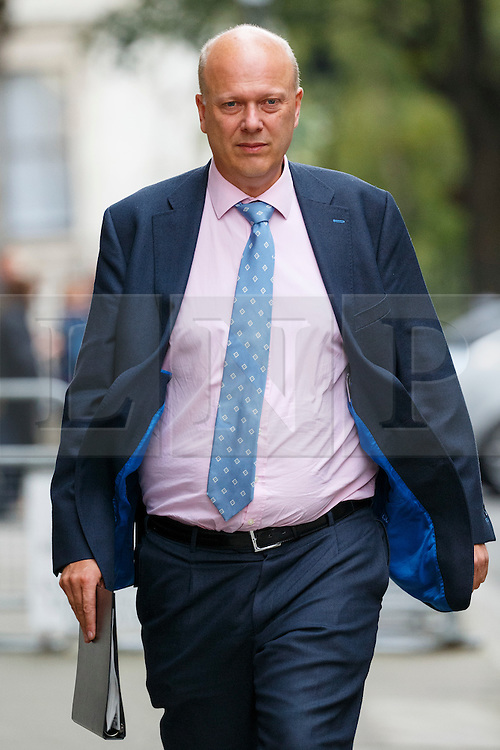 © Licensed to London News Pictures. 13/10/2015. London, UK. Leader of the House of Commons CHRIS GRAYLING leaving Downing Street after a cabinet meeting on Tuesday, 13 October 2015. Photo credit: Tolga Akmen/LNP