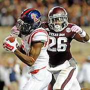 Mississippi wide receiver Quincy Adeboyejo (8) catches a touchdown pass past Texas A&M defensive back Devonta Burns (26) during the second half of an NCAA college football game in College Station, Texas, Saturday, Oct. 11, 2014. No. 3 Mississippi won 35-20. (Photo/Thomas Graning)
