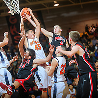 020113  Adron Gardner<br /> <br /> The Gallup Bengals and Grants Pirates clash in the lane for a rebound in Gallup Friday.