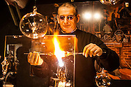 A glass blower demonstrating his craft at a Christmas Market in Dusseldörf, Germany