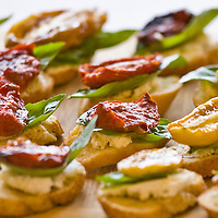 Sun-dried tomato on basil leaf hors d'oeuvres.