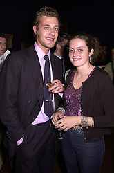 Interior designer Nina Campbell's children MR MAX KONIG and MISS ALICE DEEN, at a reception in London on 27th September 2000.OHJ 27