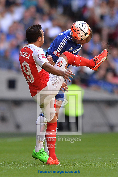 Branislav Ivanovic of Chelsea looks to win a header in the air against Santi Cazorla of Arsenal during the FA Community Shield match between Arsenal and Chelsea at Wembley Stadium, London<br /> Picture by Richard Blaxall/Focus Images Ltd +44 7853 364624<br /> 02/08/2015