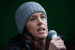 London, UK. 1st December, 2018. Liz Hutchins, Campaigns Director at Friends of the Earth, addresses the Together for Climate Justice demonstration against Government policies in relation to climate change, including Heathrow expansion and fracking. Following a rally outside the Polish embassy, chosen to highlight the UN's Katowice Climate Change Conference which begins tomorrow, protesters marched to Downing Street.