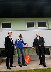 Ales Ekar of Jelovica d.d., Teja Gregorin and Gregor Bencina, general manager of Jelovica d.d. at opening ceremony of rebuilded T. Gregorin's house after she moved from Ihan, on November 10, 2011, in Hotemaze at Kranj, Slovenia. (Photo by Vid Ponikvar / Sportida)