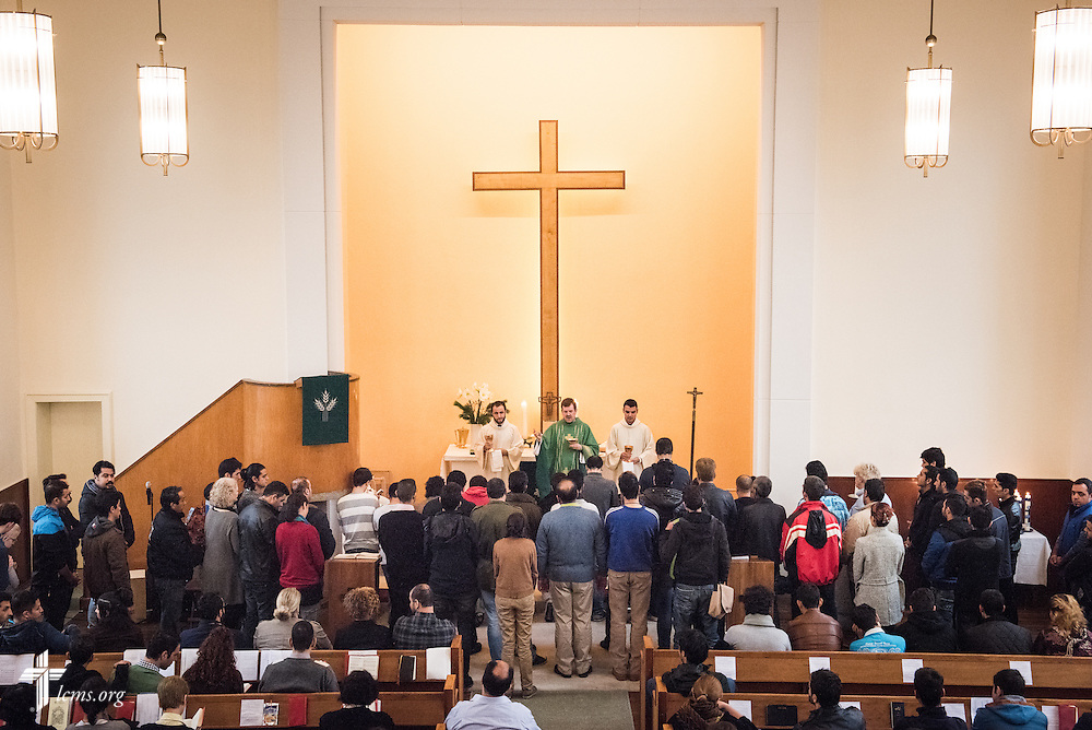 Refugees gather for communion and blessings as the Rev. Dr. Gottfried Martens leads worship on Sunday, Nov. 15, 2015, at the Dreieinigkeits-Gemeinde, a SELK Lutheran church in Berlin-Steglitz, Germany.  LCMS Communications/Erik M. Lunsford