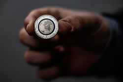 A man displays his five-euro coin outside Bundesbank, German central bank, on April 14, 2016. The German Finance Ministry issued on Thursday a new five-euro coin which bears novel features. The new five-euro coin could only be used for payments in Germany. EXPA Pictures © 2016, PhotoCredit: EXPA/ Photoshot/ Zhang Fan<br /> <br /> *****ATTENTION - for AUT, SLO, CRO, SRB, BIH, MAZ, SUI only*****