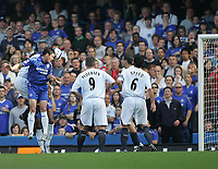 Photo: Lee Earle.<br /> Chelsea v Bolton Wanderers. The Barclays Premiership.<br /> 15/10/2005. Chelsea's Aiser Del Horno attempts a header as he is pressurised by Bolton's Kevin Davies.