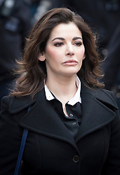 © Licensed to London News Pictures. 27/01/14 The Metropolitan Police Service (MPS) have stated there will be no further action by police against NIGELLA LAWSON in connection with drug use. FILE PICTURE DATED 04/12/2013. London, UK. Television cook, NIGELLA LAWSON arriving at Isleworth Crown Court in London to give evidence in the trial of two former personal assistants who worked for her and Charles Saatchi. The Grillo Sisters Elisabetta and Francesca have both appeared on ITV's This Morning. Photo credit : Ben Cawthra/LNP