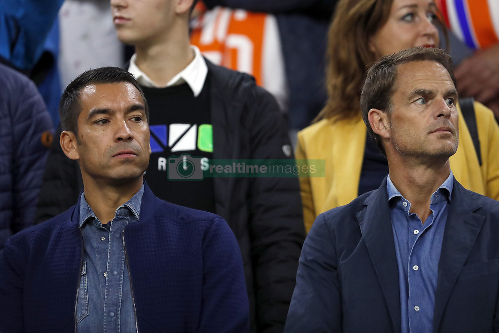 (L-R) Feyenoord coach Giovanni van Bronckhorst, Frank de Boer during the International friendly match match between The Netherlands and Peru at the Johan Cruijff Arena on September 06, 2018 in Amsterdam, The Netherlands