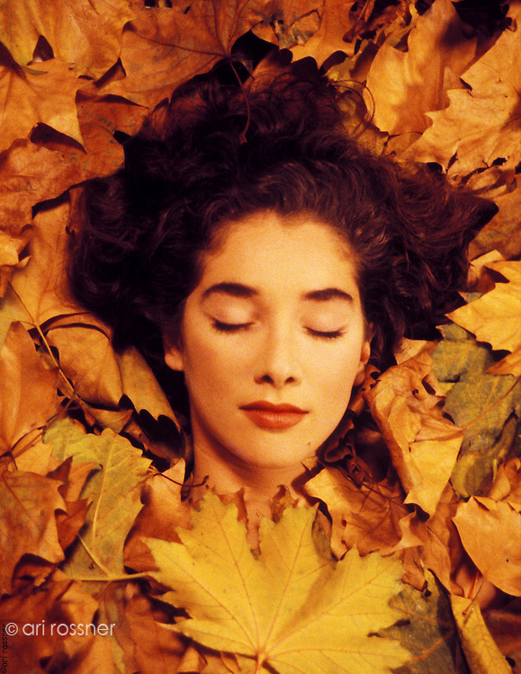 woman lying in dead leafs