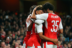 25 October 2016 - EFL Cup - 4th Round - Arsenal v Reading - Alex Oxlade-Chamberlain of Arsenal celebrates with Mohamed Elneny after scoring his 1st goal - Photo: Marc Atkins / Offside.