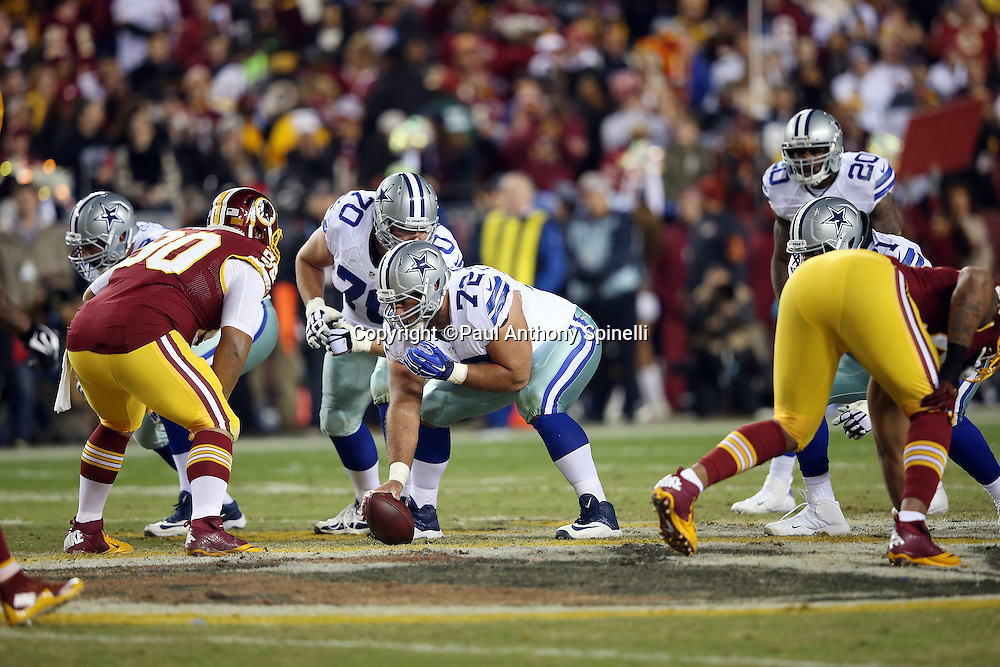 Dallas Cowboys center Travis Frederick (72) gets set to snap the ball at the line of scrimmage during the 2015 week 13 regular season NFL football game against the Washington Redskins on Monday, Dec. 7, 2015 in Landover, Md. The Cowboys won the game 19-16. (©Paul Anthony Spinelli)