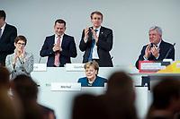 07 DEC 2018, HAMBURG/GERMANY:<br /> Angela Merkel, CDU, Bundeskanzlerin, nach Ihrer letzten Rede als Parteivorsitzende, unten links: Annegret Kramp-Karrenbauer, CDU Generalsekretaerin, unten rechts: Volker Bouvier, CDU, Ministerpraesident Hessen, hinten v.L.n.R.: Dr. Roland Heintze, CDU Landesvorsitzender Hamburg, Daniel Guenther, CDU, Ministerpraesident Schleswig-Holstein, CDU Bundesparteitag, Messe Hamburg<br /> IMAGE: 20181207-01-075<br /> KEYWORDS: party congress, Appluas, applaudiren, klatschen, Jubel, Daniel G&uuml;nther