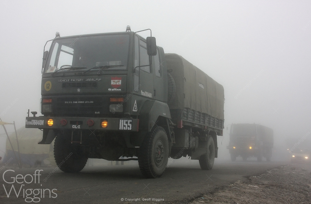 Convoy of Indian Army trucks emerge from the clouds at the Rohtang Pass, Ladakh, India