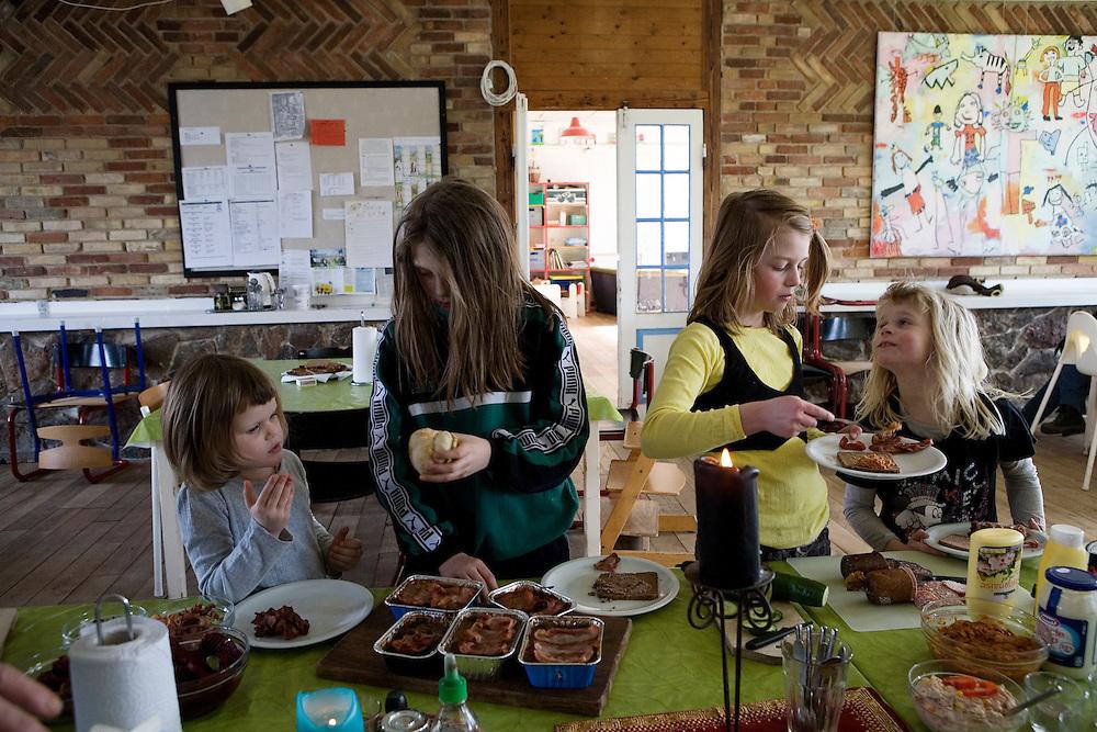 Toustrup Mark Community,  Sporup, Denmark, March 13, 2010. Girls in the dining room.