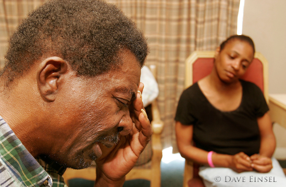 HOUSTON - SEPTEMBER 5: Harold Brown, Jr. weeps as he sits on his bed at the Western Inn in Houston, Monday, Sept. 5, 2005. Brown and his companion, April Bowie, right, escaped their 9th Ward home in New Orleans on a tractor tire and made their way to Houston several days later. .<br />