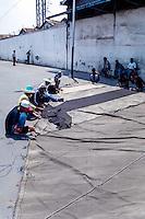 Java, East Java, Surabaya. Sail repair in Kalimas harbor.