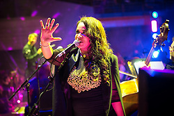 "© Licensed to London News Pictures . 05/02/2016 . Manchester , UK . ROWETTA IDAH . "" Hacienda Classical "" debut at the Bridgewater Hall . The 70 piece Manchester Camerata and performers including New Order's Peter Hook , Shaun Ryder , Rowetta Idah , Bez and Hacienda DJs Graeme Park and Mike Pickering mixing live compositions . Photo credit : Joel Goodman/LNP"