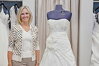 Portrait of a happy senior bridal store owner