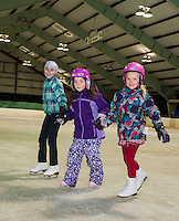 Kathrine Stow, Madeline D'Agata and Caroline Colby join together at Gilford Parks and Recreation's skating party Friday night at the Arthur Tilton Ice Rink.