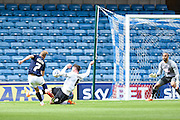 Lee Martin is fouled by Richard Keogh and wins the penalty which led to Millwall's second goal during the Sky Bet Championship match between Millwall and Derby County at The Den, London, England on 25 April 2015. Photo by David Charbit.