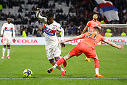 Maxwel Cornet of Lyon and Frederic Guilbert of Caen during the French Championship Ligue 1 football match between Olympique Lyonnais and SM Caen on march 11, 2018 at Groupama stadium in Decines-Charpieu near Lyon, France - Photo Romain Biard / Isports / ProSportsImages / DPPI