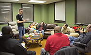 Nick Rhoades (standing) talks during a PITCH meeting in Waterloo, Iowa on Thursday, November 7, 2013. PITCH, which stands for Positive Iowans Taking Charge, is a group of HIV+ people who meet together. Seven people attended the meeting.
