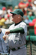 ANAHEIM, CA - APRIL 26:  Manager Joe Maddon #70 of the Tampa Bay Devil Rays opens a water bottle in the dugout during the game against the Los Angeles Angels of Anaheim at Angel Stadium in Anaheim, California on April 26, 2007. The Angels defeated the Devil Rays 11-3. ©Paul Anthony Spinelli *** Local Caption *** Joe Maddon
