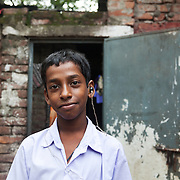 Dhaka, Bangladesh. .The Stars Foundation visiting CSID..Centre for Services and Information on Disability (CSID) is a charity working for intergrating disabled children into mainstream society. Rasel, living near the  railway tracks in Tejgaon. Rasel is hearing impaired but CSID has provided hime with hearing aid, school uniform and the school fees. Rasel want to be either a police man or a lawyer when he grows up. He lives with his mother and father and CSID has helped his fatehr set up a vegetable shop to help them raise their income and to keep Rasel from begging or working.