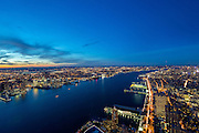 The panoramic view from One World Observatory, the observation attraction of One World Trade in New York City, photographed at sunset and dusk.