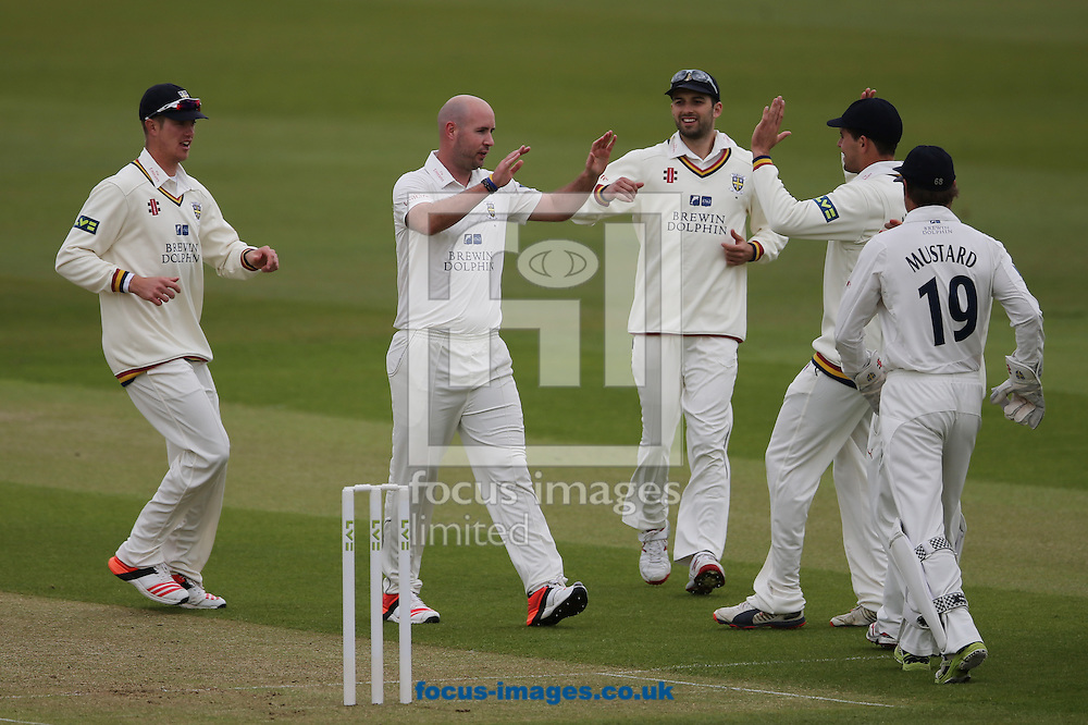 Chris Rushworth (2nd left) of Durham is congratulated on the wicket of Brendan Taylor (not shown) of Nottinghamshire  during the LV County Championship Div One match at Emirates Durham ICG, Chester-le-Street<br /> Picture by Simon Moore/Focus Images Ltd 07807 671782<br /> 10/05/2015