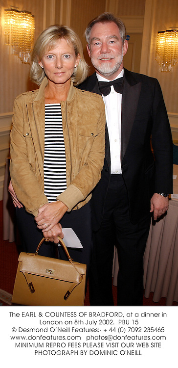 The EARL &amp; COUNTESS OF BRADFORD, at a dinner in London on 8th July 2002.<br />PBU 15