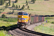 Brand new GE locomotives lead the way as yet another coal train from the northwestern Colorado coal fields on the Craig Branch descends the Rocky Mountains on the Moffat Route.