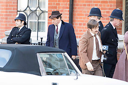 EXCLUSIVE: Hugh Grant on set as MP Jeremy Thorpe for the first day of filming 'A Very British Scandal' in Central London. Hugh, dressed in 70's 3 piece suit and hat looked remarkably like the disgraced politician as he battled his way through press in the scene. The BBC Drama marks Hugh's first TV acting gig since the 1990's and has reportedly been snapped up by Amazon for the US rights. 03 Oct 2017 Pictured: Hugh Grant. Photo credit: MEGA TheMegaAgency.com +1 888 505 6342