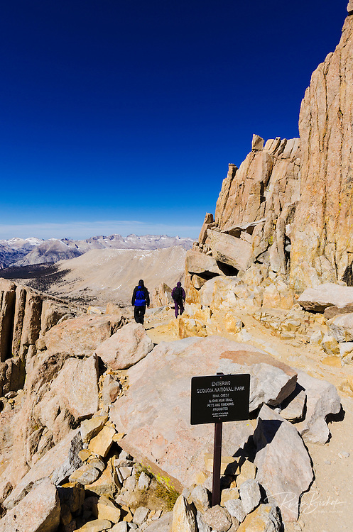 Hikers on the Mount Whitney trail at Trail Crest, Sequoia National Park, Sierra Nevada Mountains, California USA