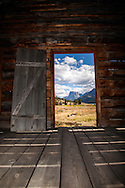 Open door, derelict homestead, Square Top Mountain, Wind River Mountains, Green River Lakes, Pinedale Wyoming.