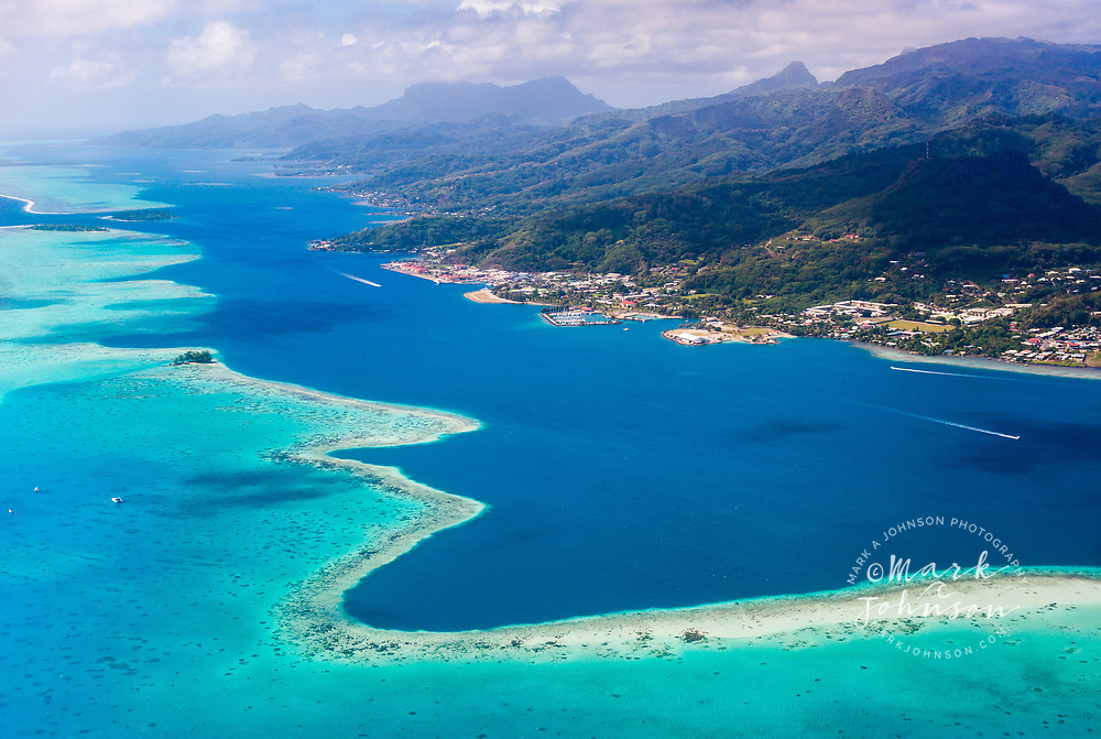 Aerial photo of the main town of Utoroa, Raiatea, on the shores of the blue lagoon, Leeward Islands, French Polynesia